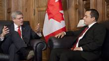 Prime Minister Stephen Harper gestures as he sits down to speak with Assembly of First Nations Chief Shawn Atleo in his office on Parliament Hill in Ottawa Thursday December 1, 2011. (Adrian Wyld/The Canadian Press/Adrian Wyld/The Canadian Press)