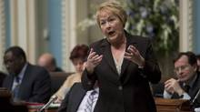Quebec Premier Pauline Marois responds to Opposition questions Wed., March 20, 2013 at the legislature in Quebec City. (Jacques Boissinot/THE CANADIAN PRESS)