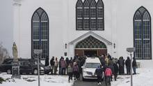 Family and friends arrive for the funerals of Lionel Desmond and his mother, Brenda Desmond, at St. Peter's Church in Tracadie, N.S. on Jan. 11, 2017. (Darren Calabrese)