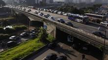 Vehicles are seen in a traffic jam during rush hour in Sao Paulo, Brazil, in a photo from 2011. A decade ago, the share of the poor in Latin America was about 2.5 times that of the middle class. Now, the middle class and the poor account for about the same share of the population, at 30 per cent, a World Bank study says . (Nacho Doce/REUTERS)