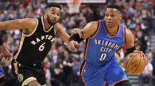 Thunder point guard Russell Westbrook goes to the basket past Raptors point guard Cory Joseph at the Air Canada Centre on Thursday. (Tom Szczerbowski/USA Today Sports)