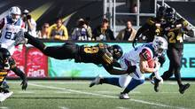 Montreal Alouettes wide receiver Samuel Giguere (15) is tackled by Hamilton Tiger-Cats Matt Wells during the second-half of CFL football action in Hamilton, Ont., on Saturday, November 5, 2016. (Peter Power/THE CANADIAN PRESS)