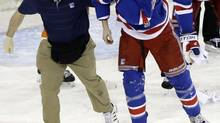 New York Rangers' Marc Staal is helped off the ice after being injured during the third period of an NHL hockey game against the Philadelphia Flyers on Tuesday, March 5, 2013, in New York. The injury has increased the call for the mandatory use of visors in the NHL. (Frank Franklin II/AP)