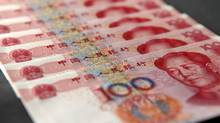 Chinese citizens cannot legally transfer more than $50,000 (U.S.) a year out of China without government permission. (Tomohiro Ohsumi/Bloomberg)