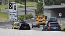 With the Toronto 2015 Pan Am & Parapan Am Games set to begin in less than two weeks, HOV lane restrictions came into effect causing some confusion with drivers being fined and losing points foe the infraction. Signage is posted reminding westbound traffic of the Gardiner Expressway about the lanes on June 29 2015. (Fred Lum/The Globe and Mail)