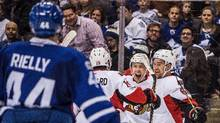 Ottawa Senators centre Derick Brassard (19) left wing Ryan Dzingel (18) and right wing Mark Stone (61) celebrate a goal by Chris Wideman (not shown) during third period NHL hockey action against the Toronto Maple Leafs in Toronto on Saturday, February 18 2017. (Aaron Vincent Elkaim/THE CANADIAN PRESS)