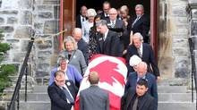 Family and friends carry the casket of former Conservative cabinet Minister Flora MacDonald during a funeral service in Ottawa, Sunday, August 2, 2015. (FRED CHARTRAND/THE CANADIAN PRESS)