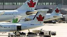 Air Canada aircraft are seen on the tarmac at Toronto Pearson International Airport. (MARK BLINCH/REUTERS/MARK BLINCH/REUTERS)