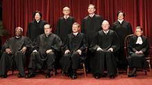 Members of the Supreme Court gather for a group portrait at the Supreme Court in Washington, Friday, Oct. 8, 2010. Seated from left are: Associate Justices Clarence Thomas, Antonin Scalia, Chief Justice John Roberts, Associate Justices Anthony M. Kennedy, and Ruth Bader Ginsburg. Standing, from left are: Associate Justices Sonia Sotomayor, Stephen Breyer, Samuel Alito Jr., and Elena Kagan. (Pablo Martinez Monsivais/AP/Pablo Martinez Monsivais/AP)