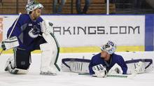 Vancouver Canucks goaltenders Roberto Luongo and Cory Schneider talk during practice for Game 4 of their NHL Western Conference quarter-final hockey playoff against the Los Angeles Kings. (DANNY MOLOSHOK/Reuters)
