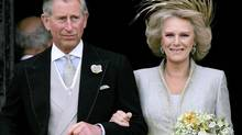 Britain's Prince Charles and his bride Camilla Duchess of Cornwall leave St George's Chaple in Windsor, England following the church blessing of their civil wedding ceremony in this Saturday, April 9, 2005 file photo. (ALASTAIR GRANT/AP)