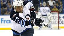 The Winnipeg Jets and Dustin Byfuglien stand to gain the most from NHL realignment writes Eric Duhatschek. (file photo) (MIKE CARLSON/AP)