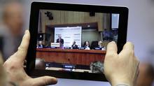Some discount brokerages offer incentives such as iPads when investors open a new account. (Richard Drew/AP)