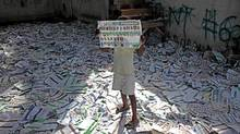A child holds up an unmarked election ballot, one of thousands left scattered on the floor of a polling station, the day after general elections in Port-au-Prince, Haiti, Monday Nov. 29, 2010. Haiti wrapped up their Sunday elections in discord while results were not likely until Dec. 7 and run-offs were expected for the presidential and nearly all senatorial and parliamentary races. (Ramon Espinosa/AP/Ramon Espinosa/AP)