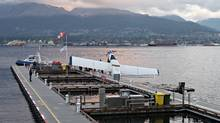 A plane, belonging to Harbour Air, lies partially submerged at the new dock facilities at the float plane terminal in Vancouver on November 5th, 2011. (Simon Hayter For The Globe and Mail/Simon Hayter For The Globe and Mail)