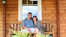 Couple on a cottage porch. (Tatjana Strelkova/Thinkstock)