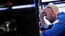 A trader works at his post on the floor of the New York Stock Exchange (NYSE) May 18. (Brendan McDermid/Reuters)