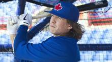 Toronto Blue Jays' Colby Rasmus hits in the batting cage at the team's spring training facility in Dunedin, Florida February 16, 2013. (FRED THORNHILL/REUTERS)