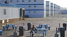 A worker relaxes outside at the Wapasu Lodge located north of Fort McMurray, Alberta. The massive camp houses about 4000 oil sands workers. (Photo by Kevin Van Paassen/The Globe and Mail) (Kevin Van Paassen/Kevin Van Paassen/The Globe and Mail)