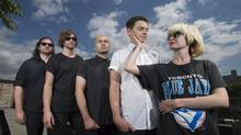 Local indie band July Talk is photographed on the rooftop of their Toronto recording studio on July 10 2014. From left are Ian Docherty, Josh Warburton, Danny Miles, Peter Dreimanis and Leah Fay. (Fred Lum/The Globe and Mail)