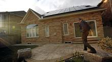 Paul Ford, who agreed to have solar panel put on the roof of his house, poses for a photo at his home in Mississsauga, Ontario, Canada. (Deborah Baic/Globe & Mail)