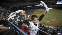Toronto Blue Jays fans wave rally towels at the team's MLB American League baseball home opener against the Boston Red Sox in Toronto April 9, 2012. (Fred Thoronhill/REUTERS)