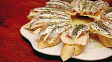 Adventurous chefs are pushing the boundaries of the traditional pintxos, which tide over hungry customers waiting for the late Spanish supper hour. (Alvaro German Vilela)