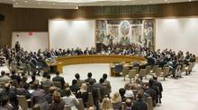 The United Nations Security Council votes on a resolution that threatens Syria with new sanctions on Thursday. The resolution failed after it was vetoed by Russia and China. (Mark Garten/Associated Press)