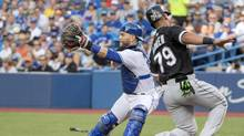 Jose Abreu of the Chicago White Sox beats a tag by Blue Jays catcher Russell Martin at the Rogers Centre Friday. (Nick Turchiaro/USA Today Sports)