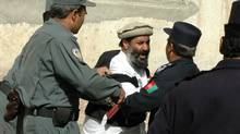 Mir Zaman, brother of Commander Deedar, a jihadi leader who was disqualified from the election, led dozens of the warlord's followers in a charge against a line of police protecting the Electoral Complaints Commission on Wednesday. 2005 (Graeme Smith/The Globe and Mail)