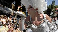 A drag queen blows fairy dust into the crowd during the Gay Pride Parade in Vancouver, Sunday, August 5, 2007. ( (Richard Lam/ The Globe and Mail/Richard Lam/ The Globe and Mail)