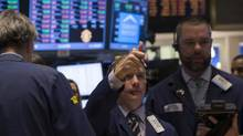 A trader gives a thumbs up while he works on the floor of the New York Stock Exchange February 3, 2014. (BRENDAN MCDERMID/REUTERS)