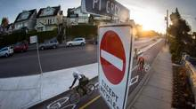 Cyclists travel along the separated bike lane on Point Grey Road in Vancouver, B.C., on Thursday January 1, 2015. (DARRYL DYCK/THE GLOBE AND MAIL)