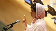 Malala Yousafzai, gives her first speech since the Taliban in Pakistan tried to kill her for advocating education for girls, at the United Nations Headquarters in New York, July 12, 2013. Wearing a pink head scarf, Yousafzai told U.N. Secretary-General Ban Ki-moon and nearly 1,000 students from around the world attending a Youth Assembly at U.N. headquarters in New York that education was the only way to improve lives. (BRENDAN MCDERMID/REUTERS)