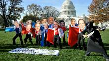 Oxfam America activists dress as members of the U.S. supercommittee on Oct. 26, 2011, in Washington D.C. (Karen Bleier/AFP/Getty Images/Karen Bleier/AFP/Getty Images)