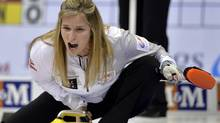 Skip Jennifer Jones yells to her sweepers against Team Homan during draw 11 at the Roar of the Rings Canadian Olympic curling trials in Winnipeg, December 4, 2013. (Reuters)