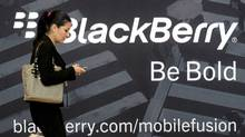 A woman uses her mobile phone at the Blackberry World Event in Orlando May 1, 2012. ) (David Manning/Reuters/David Manning/Reuters)