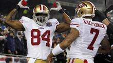 San Francisco 49ers wide receiver Randy Moss (L) and quarterback Colin Kaepernick celebrate after Moss' touchdown reception in the first quarter of their NFL football game against the New England Patriots in Foxborough, Massachusetts December 16, 2012. (JESSICA RINALDI/REUTERS)