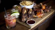 The Half Stop platter, which includes beef back ribs, St. Louis pork rib, brisket, smoked chicken and pulled pork with hush puppies, cornbread and honey butter is pictured at the Buckstop BBQ restaurant in Vancouver, British Columbia on April 15, 2014. (Ben Nelms For The Globe and Mail)