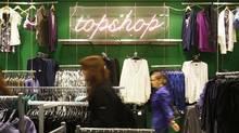 People look at clothes in a TopShop store in London. (Luke MacGregor /Reuters/Luke MacGregor /Reuters)