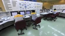 In this photo taken on Monday, Aug. 23, 2010, and released by the International Iran Photo Agency, Iranian technicians work at the Bushehr nuclear power plant, outside the southern city of Bushehr, Iran. Iran's nuclear chief said Tuesday Nov. 23, 2010 that a malicious computer worm known as Stuxnet has not harmed the country's atomic program and accused the West of trying to sabotage it. (Ebrahim Norouzi/AP)