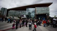 People gather on the plaza outside the new Surrey City Hall during the official opening in April. (DARRYL DYCK For The Globe and Mail)