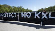 The Washington Monument backdrops a protest banner against the proposed Keystone XL oil pipeline, by an alliance of natives, cowboys, ranchers and farmers, on April 24, 2014. (Manuel Balce Ceneta/Associated Press)