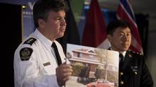 Inspector Brad Desmarais, left, and Jim Chu, Vancouver Police Chief Constable, discuss B.C.'s civil forfeiture program including one of the most valuable properties ever forfeited in the Lower Mainland during a press conference at City Hall in Vancouver, January 11, 2011. (Rafal Gerszak For The Globe and Mail)