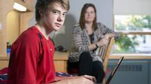 Connor Orsava, a new boarding student at Rothesay Netherwood School in New Brunswick, can stay in touch with his mother, Susan Armstrong, using a variety of methods endorsed by the school – Skype, BlackBerry Messenger and Facebook. (Andrew Meade for The Globe and Mail)