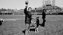 In this file photo, Sam Sianis, owner of the Billy Goat Tavern in Chicago, acknowledges the crowd along with his goat prior to a National League playoff game between the San Diego Padres and the Cubs in Chicago. (Anonymous/AP)