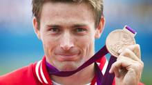 Canada's Mark Oldershaw celebrates his bronze medal win in the men's C1 1000 meter final at at the 2012 Summer Olympics. (Kevin Van Paassen/The Globe and Mail)