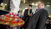 Toronto Mayor Rob Ford and the National Ballet of Canada's artistic director Karen Kain look over ballet costumes at City Hall on Nov. 14, 2011. Mr. Ford has agreed to make a cameo in The Nutcracker. (Moe Doiron/The Globe and Mail/Moe Doiron/The Globe and Mail)