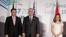 German Foreign Minister Sigmar Gabriel, left, U.S. Secretary of State Rex Tillerson and Canada's Foreign Affairs Minister Chrystia Freeland pose for a photo during a G7 foreign ministers meeting in Lucca, Italy, April 11, 2017. (MAX ROSSI/REUTERS)