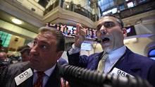 Traders work on the floor of the New York Stock Exchange June 5, 2012. (Brendan McDermid/REUTERS)